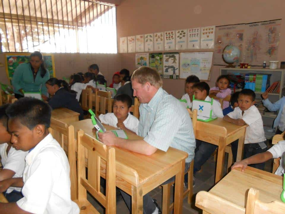 Greg works with students at the new computer lab desks.