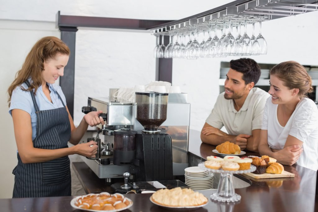 Barista in bakery cafe that serves specialty coffee