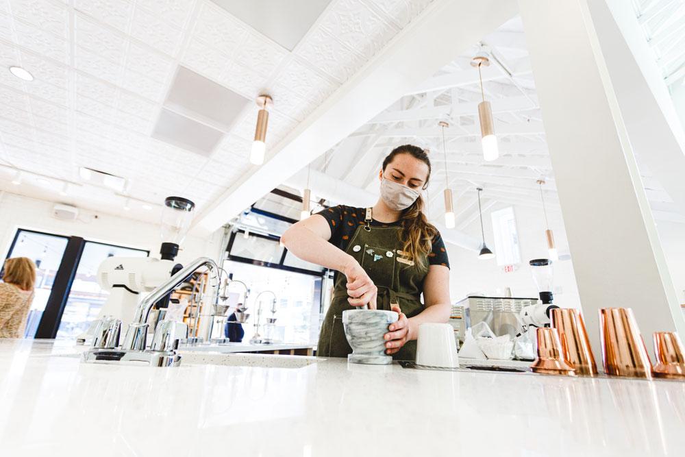 Barista prepares coffee drink