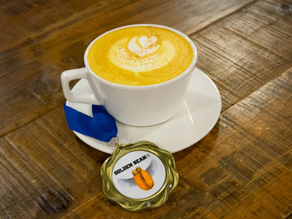 Crimson Cup Golden Bean Turmeric Latte with Golden Bean Medal