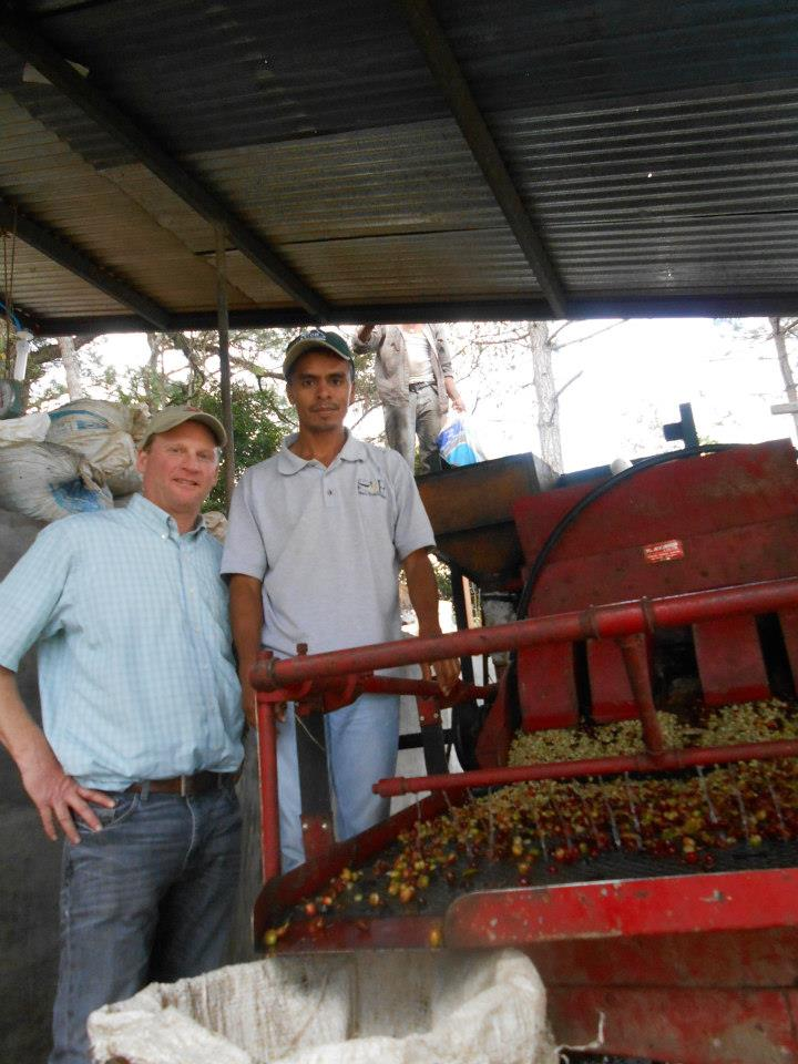 Greg (front) and David Lopez at the wet mill, where the coffee cherries are de-pulped.