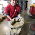 Crimson Cup Master Roaster Dave Rochus with Green Coffee Beans