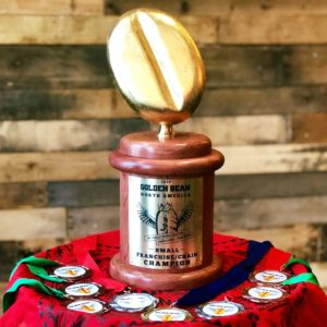 Image of coffee roasting trophy and medals for Golden Bean North America