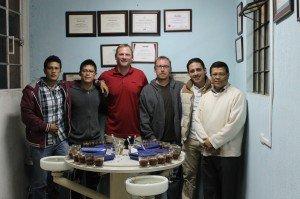 Greg Ubert and Dave Eldridge of Crimson Cup Coffee & Tea cup coffee with the De Leon family in Guatemala