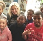 Melissa Rogner of Crimson Cup Coffee and Tea with Ohio Avenue Elementary School students