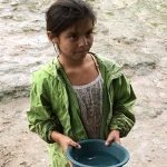 Honduran child with water bucket