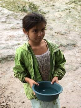 Honduran child with water pan