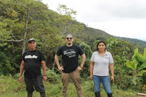 Brandon Bir of Crimson Cup Coffee & Tea (center) with Peruvian coffee growner Selena Contreras Obregon (right) and her father
